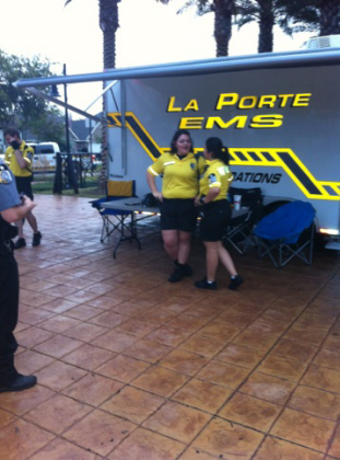 EMTs with yellow shirts and black shorts outside the EMS tent at a half marathon