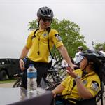 2 bike medics laughing and relaxing on their break at the festival