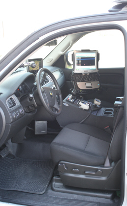 Inside the front seat of an EMS vehicle with a laptop and GPS system
