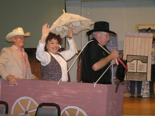 Three senior citizens participating in a performing arts activity