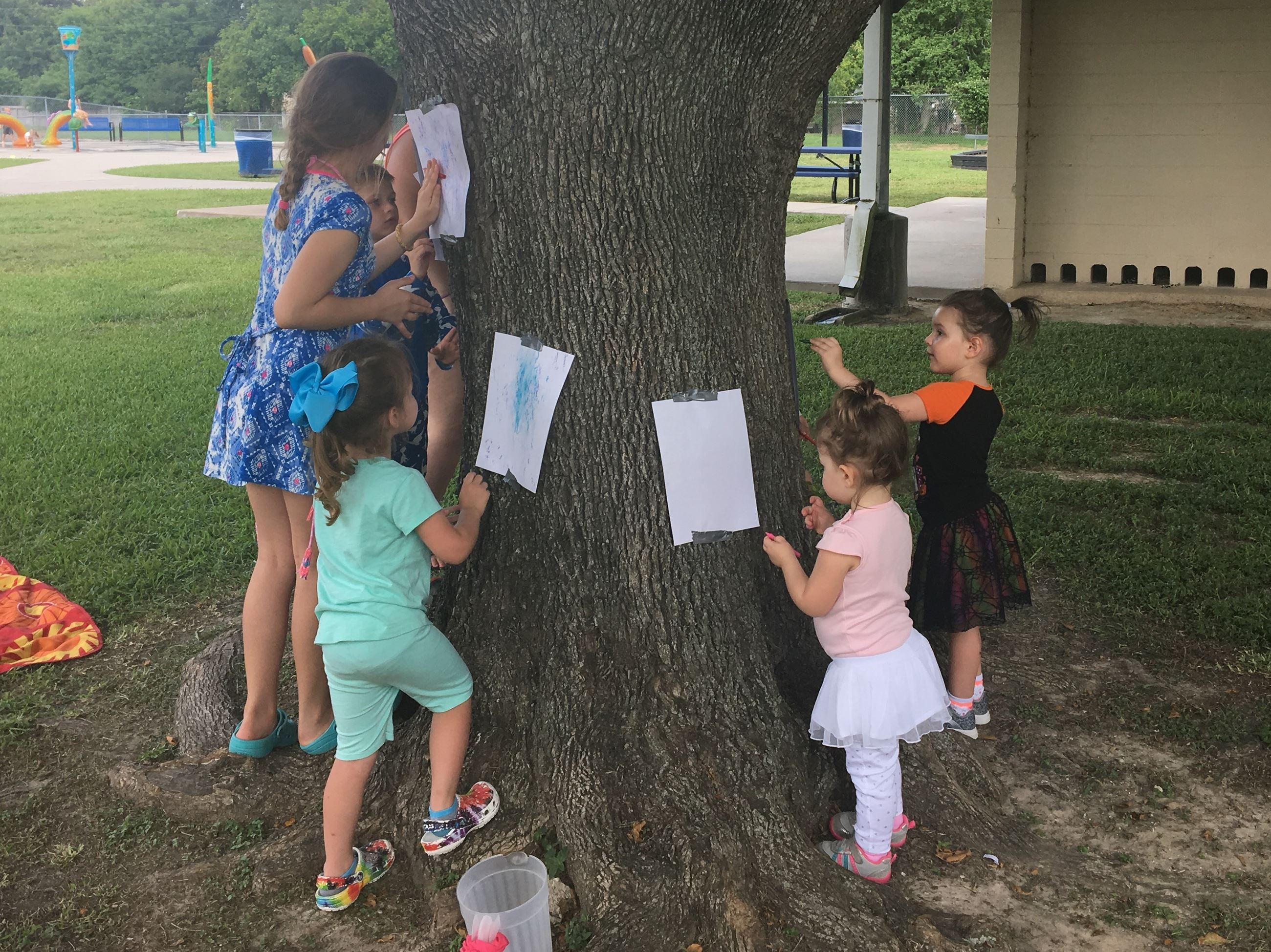 Kids coloring on a tree