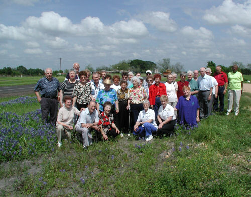 A large group of older adults enjoying an outdoor group activity